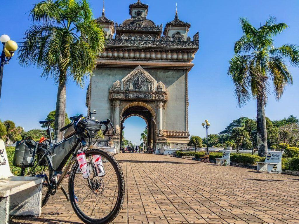 Laos Bike Tour Vientiane Patuxai Bombtrack Beyond